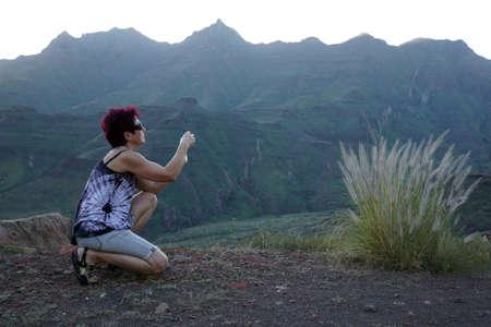 Mountain landscape near Mogan, woman photographed fountain grass, Gran Canaria, Canary Islands, Spain Stock Photo