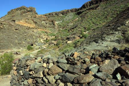 mit: Arch?ologische Zone Canada de los Gatos mit Resten pr?hispanischer H?user, Puerto de Mogan, Gran Canaria, Kanaren, Spanien, Stock Photo