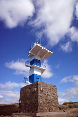 gran canaria: striped blue-white lighthouse - hike from Puerto de Mogan on the Lomo de tabaibales, Puerto de Mogan, Gran Canaria, Canary Islands, Spain Stock Photo