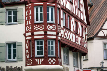 fachwerk: Half-timbered house in the historic old town Ansbach, Bavaria, Germany Stock Photo