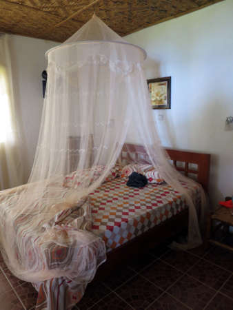 Mosquito net over the bed, Pintuyan, Panaon Island, Southern Leyte, Philippines