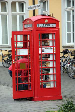 sharing point for used books in an old English telephone box, Bruehl  Rhineland, North Rhine-Westphalia, Germany