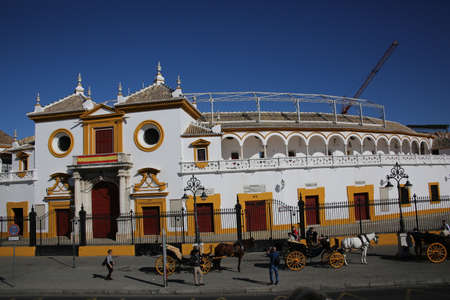 Carriages wait in front of the bullfight arena La Real Maestranza on tourists, Sevilla, Andalusia, Spain