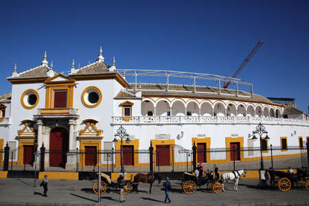 Coaches wait in front of the bullring La Real Maestranza for tourists, Sevilla, Andalusia, Spain