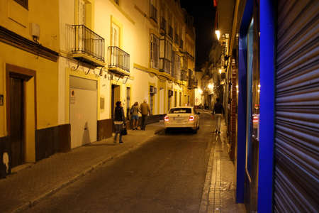 typical street in the historic old town at night, Sevilla, Andalusia, Spain