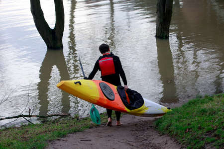Kayaker rides up the Rhine high water, North Rhine-Westphalia, Germany, Cologne