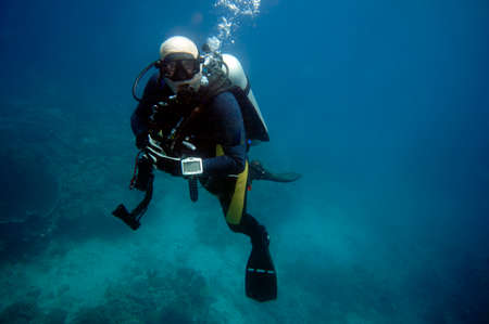 Diver with underwater camera, Pintuyan, Panaon Island, Southern Leyte, Philippines