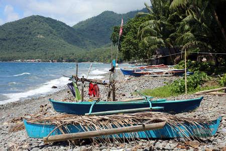 Fishermans boat on pebble beach, Pintuyan, Panaon Island, Southern Leyte, Philippines,