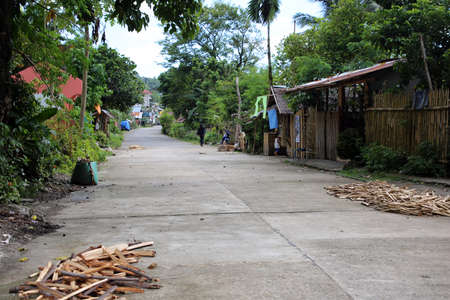 Firewood logs are for sale on the road, Pintuyan, Panaon Island, Southern Leyte, Philippines Editorial
