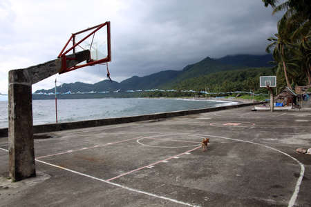 orphaned basketball field by the sea, Pintuyan, Panaon Island, Southern Leyte, Philippines Editorial