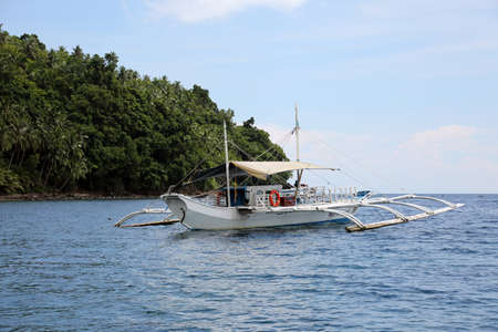 Outrigger boat off the coast of Panaon Island, Southern Leyte, Philippines