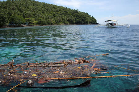 Flotsam collects in a bay off the coast of Panaon Island, Southern Leyte, Philippines