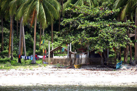 Residential house on the beach among palm trees, Pintuyan, Panaon Island, Southern Leyte, Philippines