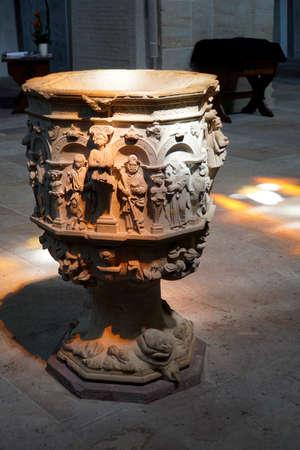 Baptismal basin in the monastery church of Abbey Loccum, Rehburg-Loccum, Lower Saxony, Germany Editorial
