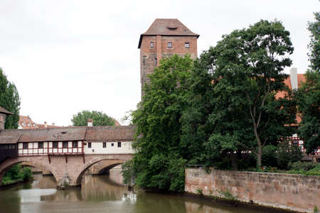 historic old town Nuremberg - hangman footbridge with hangman flat and water tower, today dorm, bavaria, germany