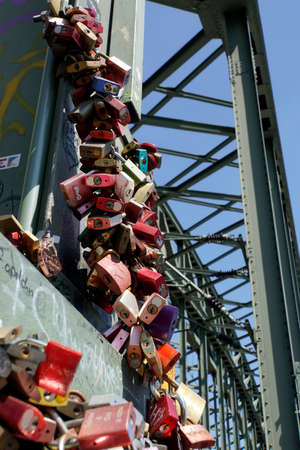 Love locks on the Hohenzollern bridge, Cologne, North Rhine-Westphalia, Germany Sajtókép