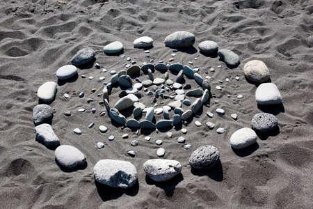 Pattern of stones on black lava beach, Puerto de Tazacorte, La Palma, Canary Islands, Spain