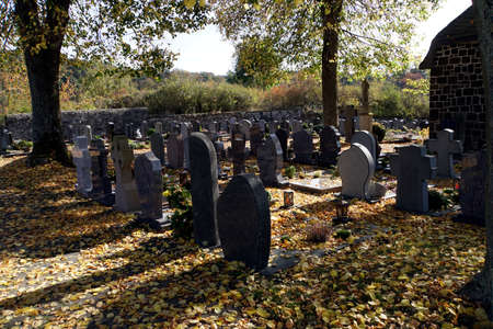 Symbol picture Cemetery in autumn, Elm, Rhineland-Palatinate, Germany Standard-Bild - 110762473