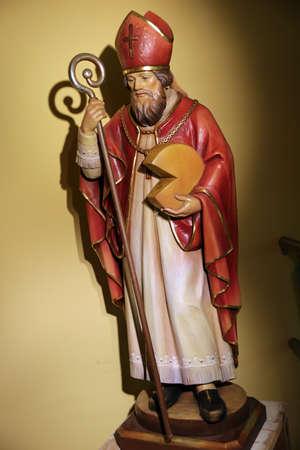 Wood sculpture St. Theodul, patron saint of Dobbiaco Dairy, South Tyrol, Italy Stock Photo