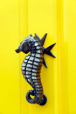 Metal door knocker in the form of a seahorse, Valletta, Malta Stock Photo