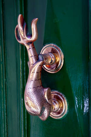 Metal door knocker in the shape of a fish, Valletta, Malta Stock Photo