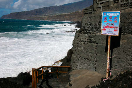 Deserted beach Playa el Charcon in strong surf, Tazacorte, La Palma, Canary Islands, Spain