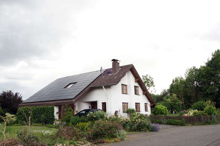 Detached house in country house style with photovoltaic system