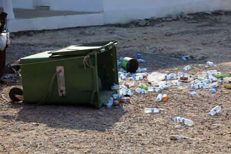 Empty plastic water bottles in front of an overturned dumpster, Dipkarpaz, Turkish Republic of Northern Cyprus