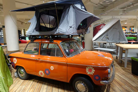 Roof tent on NSU oldtimer - inside view of Globetrotter branch Cologne, North Rhine-Westphalia, Germany