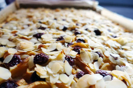 Sheet cake with apples, cherries and sliced almonds