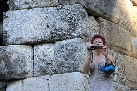 Ruins of the ancient port city of Phaselis in Lycia - Toristin films with a video camera, Kemer, Turkey