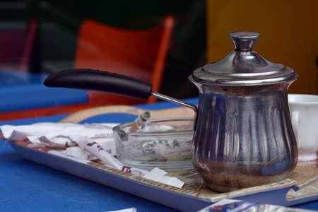 lebanese: jar of Lebanese coffe on serving tray