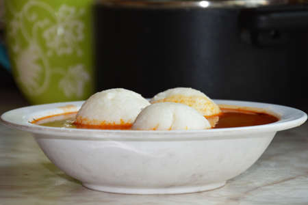 holiday food: Ghana Holiday food Omotuo riceballs with Groundnut soup