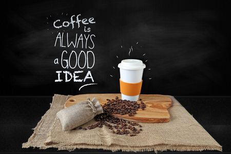 Coffee cup, coffee beans on chalkboard background