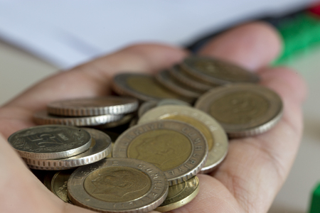Handful of coins in palm hand, a lot of Turkish lira coins. Stok Fotoğraf