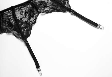 Garter belt isolated on white background. Sexy lingerie for women. Erotic underwear, black delicate girdle. Passion and romantic theme. Happy Valentine's Day.