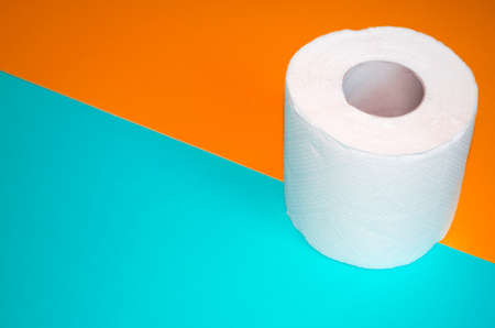 Toilet paper top view. Hygiene stuff and body care products for everyday. Banner with paper towel and copy space.