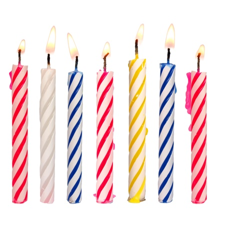Set of colored birthday candles isolated on white photo