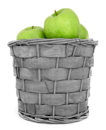 Basket with green apples and slice isolated on white Stock Photo - 13391667