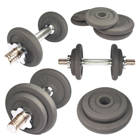 kilos: Collection of dumbbells and weights isolated on white