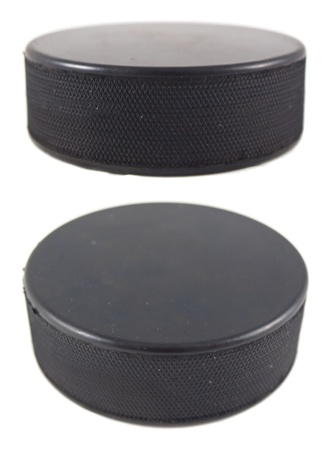 hockey puck: Puck isolated on white Stock Photo