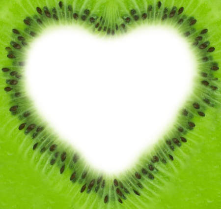 Kiwi slice with white space forming heart photo