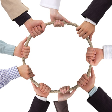 Hands holding rope forming a circle with white space for text photo