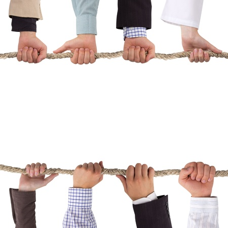 unity is strength: Hands holding a rope isolated on white, conceptual background