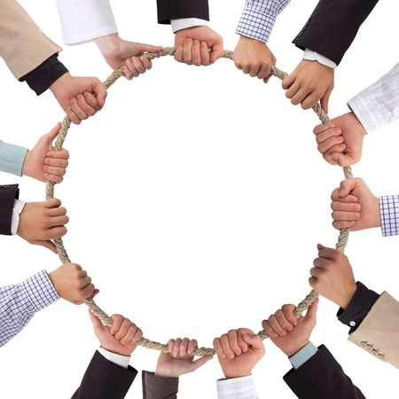 strong partnership: Hands holding rope forming a circle