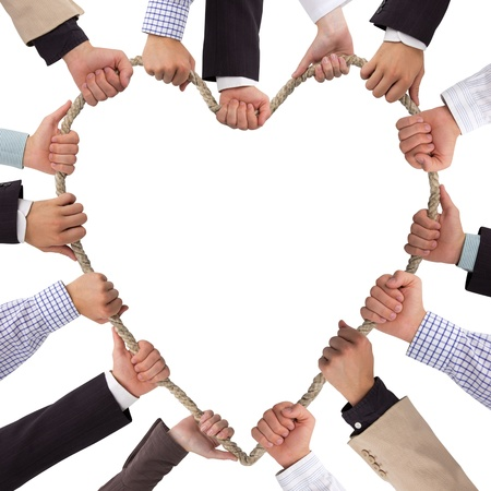 Hands holding rope forming heart photo