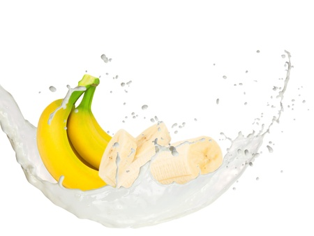 Milk splash with bananas isolated on white photo