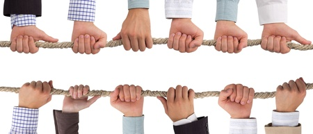 Hands holding rope, teamwork concept Stock Photo - 14662784