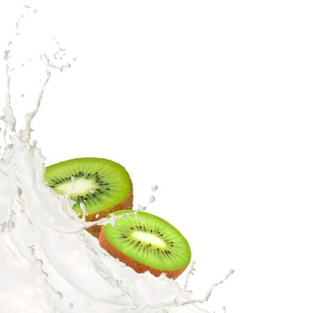Milk splash with kiwi isolated on white photo