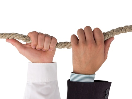 Hands holding rope, teamwork concept Stock Photo - 14738829